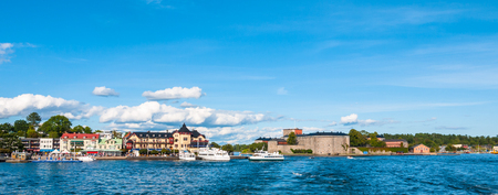 Panorama view of Vaxholm town and the castle from the cruise ship, on a sunny summer day in the Vaxholm Municipality, Stockholm County, Sweden Stock Photo