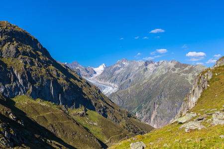 Panorama view towards the Aletsch glacier in summer on the hiking path on Bernese Oberland, Switzerland
