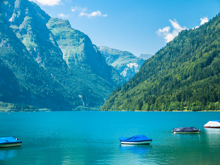 glarus: Stunning view of Kloentaler lake (Kloenthalsee) in Summer, Canton of Glarus, Switzerland