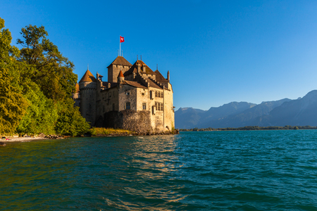 chillon: Beautiful view of Chillon castle at dusk in the golden sunshine, on the lakeside of Lake Geneva, Montreux, Canton of Vaud, Switzerland