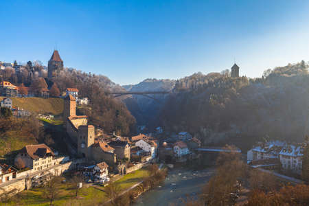 Stunning panorama view of Bern Bridge, Bern Gate, Gotteron Bridge with river, Sarine river flowing in the valley on a sunny winter day from Zaehringen Bridge with blue sky, Fribourg, Switzerland Imagens