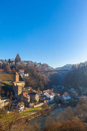 Stunning aerial view of Bern Bridge, Bern Gate, Gotteron Bridge with river, Sarine river flowing in the valley on a sunny winter day from Zaehringen Bridge with blue sky, Fribourg, Switzerland Imagens