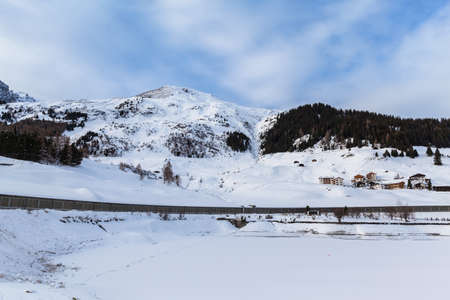 Panorama view of the frozen Davos Lake, the Davos village and the Alps in winter, Canton of Grisons, Switzerland