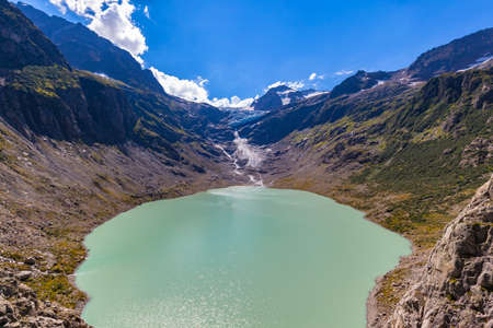 Panorama view of Trift lake (Triftsee) and glacier from the suspension bridge, Canton of Berne, Switzerland.