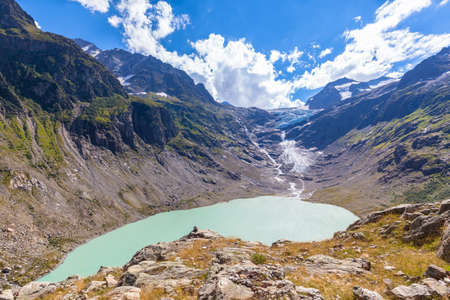 Stunning view of Trift lake (Triftsee) and glacier from the suspension bridge, Canton of Berne, Switzerland. Imagens
