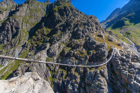 Stunning view of Trift bridge, a suspension bridge over the Triftsee, glacier, in Gimsel on Bernese Oberland, Switherland.