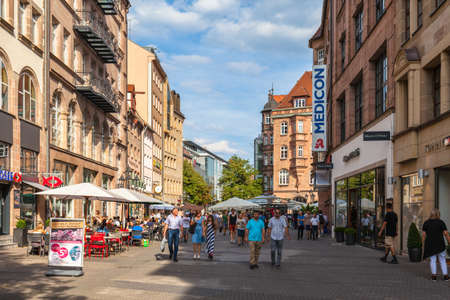 Nuremberg, Germany - September 2, 2016 - People hanging around at the pedestrian area with lots of shops and restaurants in the old town of Nuremberg, Bavaria, Germany