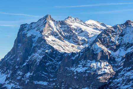 Stunning view of peak Wetterhorn of swiss alps from Kleine Scheidegg in Winter, on Bernese Oberland near Jungfrau, Switzerland.