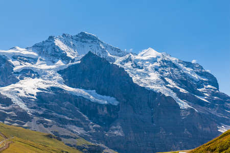 View of the famous peak Jungfrau of the swiss Alps on Bernese Oberland in Switzerland. It is one of the main summits of the Bernese Alps, located betweensouthern canton Bern and northern canton Valais.