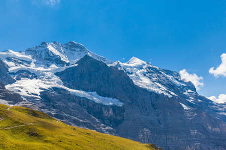 View of the famous peak Jungfrau of the swiss Alps on Bernese Oberland in Switzerland. It is one of the main summits of the Bernese Alps, located between southern canton Bern and northern canton Valais.