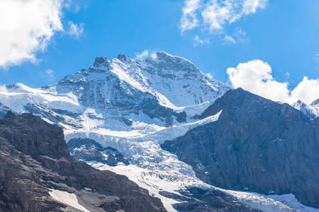 View of the famous peak Jungfrau of the swiss Alps on Bernese Oberland in Switzerland. It is one of main summits of the Bernese Alps, located between the southern canton of Bern and northern canton Valais. Banco de Imagens