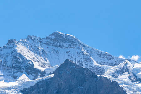 View of the famous peak Jungfrau of the swiss Alps on Bernese Oberland in Switzerland. It is one of the main summits of the Bernese Alps, located between the southern canton of Bern and the northern canton of Valais.