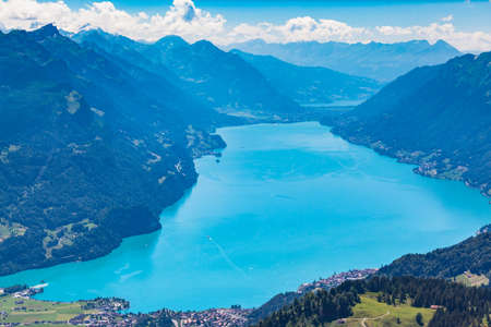Stunning view of the Brienz lake and the alps from the mountains on hiking trail on Bernese Oberland near the famous tourism region of Interlaken, Jungfrau region, Switzerland.