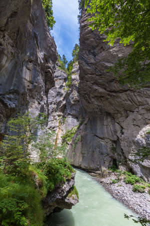 View of the Aare Gorge in Hasli valley on Bernesr Oberland, Switzerland. It is between Meiringen and Innertkirchen is nearly 200 meters deep and hardly more than a meter wide at its narrowest point. Stock Photo