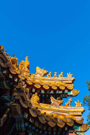 Colored glaze made of statue on ancient imperial roof decorations, Beijing, China,