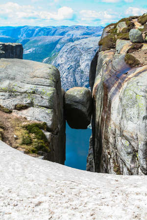 Close view of the famous boulder Kjeragbolten above the Lysefjorden on the mountain Kjerag in Forsand municipality in Rogaland county, Norway. Stock Photo