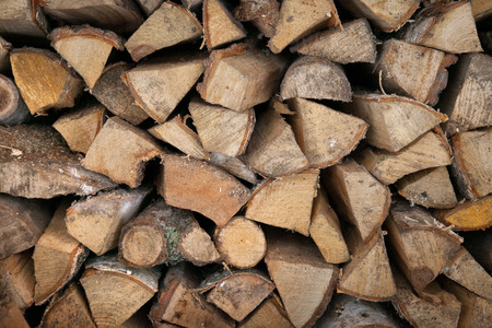 Neatly stacked wooden firewood. Stoke the fireplace. Background. Close-up