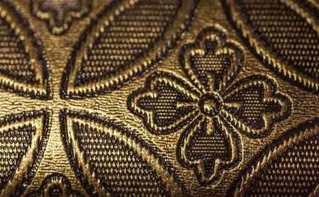 Gold-plated, antique, gothic ornament. Ancient art Close-up Background Reklamní fotografie