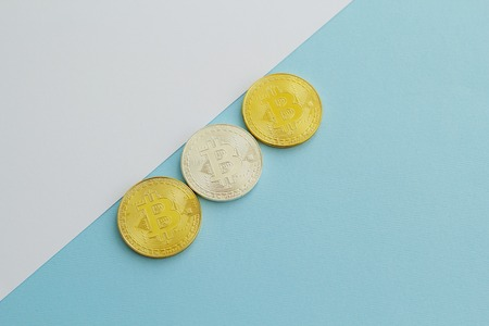 Picture of bitcoin over white and blue background Stock Photo