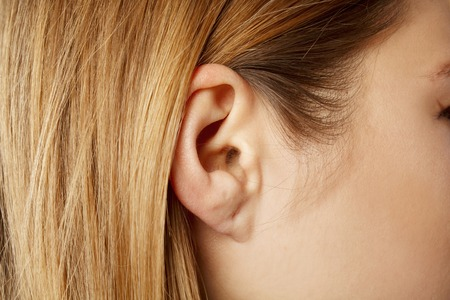 Detail of the head with female human ear Stock Photo