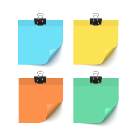 Colorful post it paper pieces with paper clips