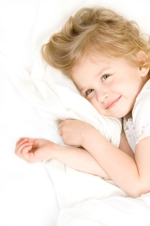 Adorable little girl resting in the bed close-up Stock Photo - 10060375