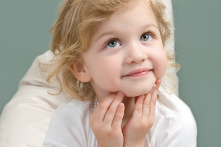 Adorable little girl looking up and dreaming close-up on white background Stock Photo - 10060376