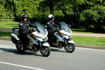Washington,USA -May 16th 2009:Two police officers riding motorcycles Editorial