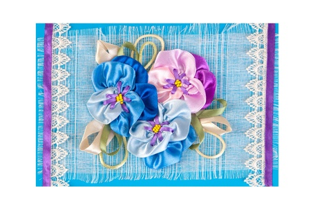 greeting card with bunch of artificial flowers on blue