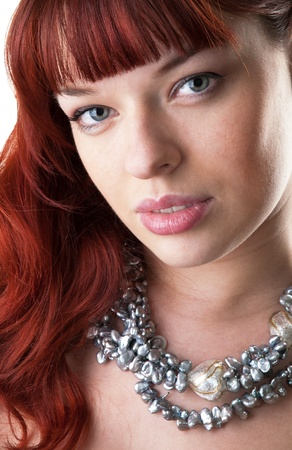 red haired girl and a pearl necklace close-up