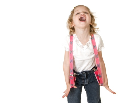 suspenders: beautiful little fashion model on white background screaming and stretching her red suspenders out to the sides