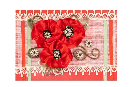 greeting card with bunch of artificial red flowers on red
