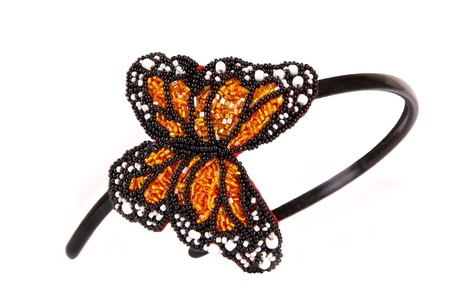 headband with artificial butterfly of beads isolated on white