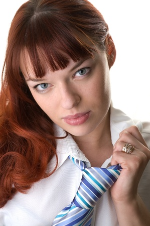 red haired businesswoman wearing a shirt and a tie close-up