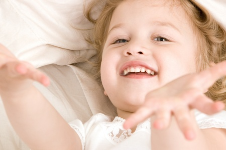 Adorable little girl resting in the bed closeup Banco de Imagens