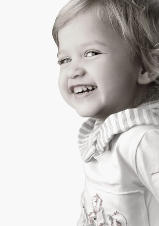 Smiley happy little girl close-up on white background  Stock Photo