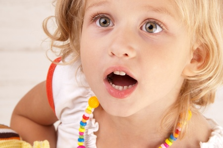 Surprised amazed little girl close-up Stock Photo - 10273172