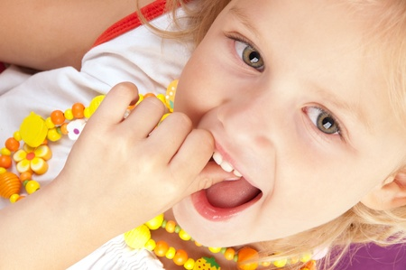 Cheerful little girl close-up