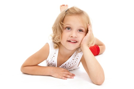 Little girl lying on the floor, looking up and dreaming on white  background
