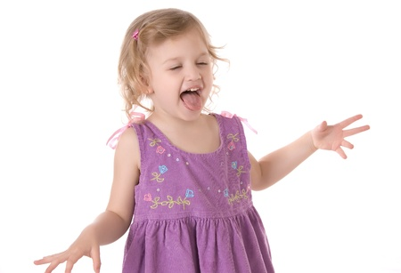 fretful little girl wearing a purple dress screaming with ones tongue hanging out and standing on white background