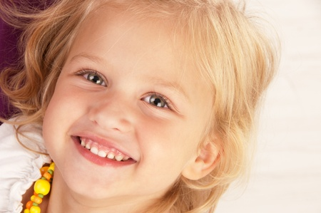Cheerful little girl close-up photo