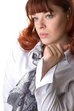 red haired woman wearing a blouse and a scarf close-up  photo
