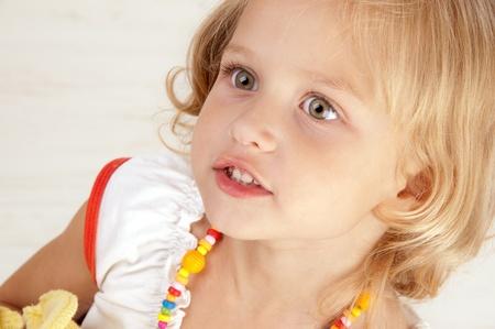 Surprised amazed little girl close-up photo
