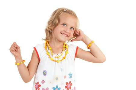 Cute little girl posing for the camera and looking up on white background