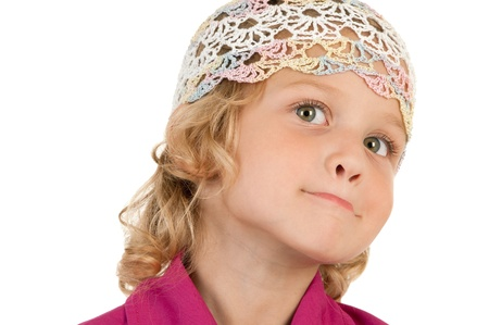 Cute little girl poses for the camera on white background close-up Stock Photo