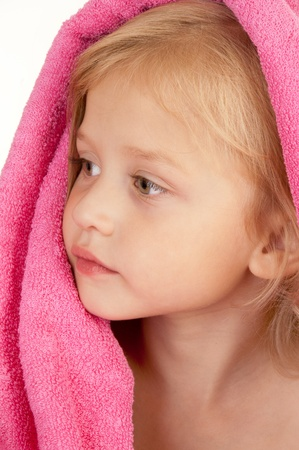 Pretty little girl wrapped in a pink towel close-up Stock Photo - 10369412