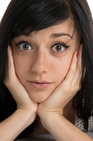 Beautiful brunette girl with a surprised expression on her face  close-up