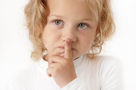 Blonde little girl dressed in white  on  white background closeup photo