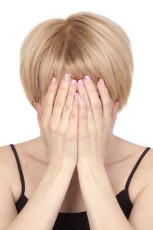 Young beautiful   blonde woman covers her face with her hands  closeup photo