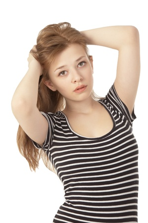 ttractive: Beautiful girl at the age of fifteen looking at the camera close-up on white background Stock Photo